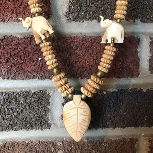 African bone carved necklace; elephants